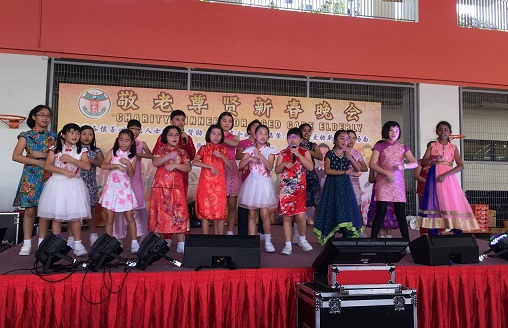 Choir members performing at The Senior Citizen's Nite organized by Chong Ghee Temple and Residents Committee in the neighbourhood.