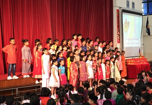 Choir members performing with some non-Chinese schoolmates for the school's annual Chinese New Year celebration.