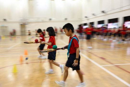 Primary one students competing against their classmates in the Indoor Sports Hall (ISH)