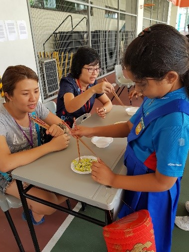 Students doing their hands-on activities at the cultural booths during recess - 01
