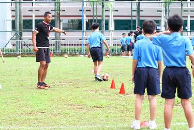 Coach Isa Halim instructed one of our Riverlites during the Soccer Skills Challenge