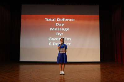 Reading of the Total Defence Day message by Gwen Lim from 6 Respect