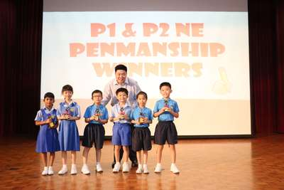 Prize presentation for Penmanship Competition held in conjunction with Total Defence Day
